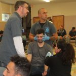 man holding a patient's head in timer emt training course